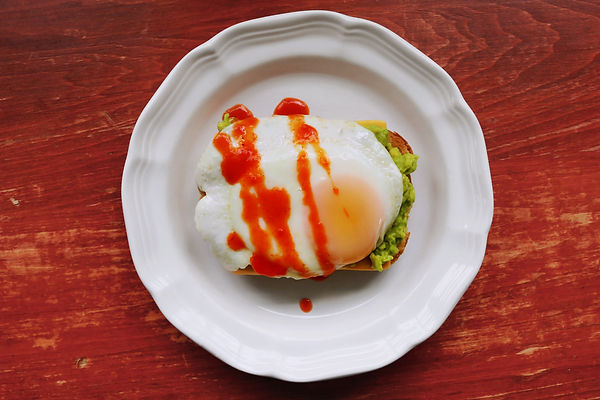 egg and avocado toast with sansonetti sauces roasted red pepper hot sauce