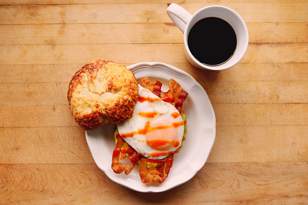 egg bacon and avocado bagel breakfast sandwich with sansonetti sauces roasted red pepper hot sauce