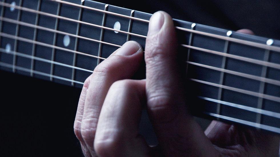 Hands on Guitar Strings_edited.jpg