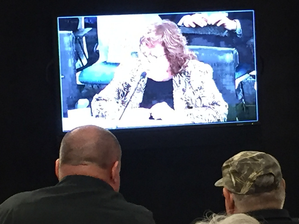 Union representatives waiting to speak against RECE 4.10 in Joshua Tree, watch Terri Rahhal, Planning Director for Land Use Services, provide the initial staff report at the special meeting on February 28, 2019.