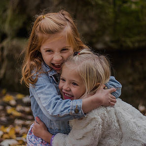 Two girls hugging.