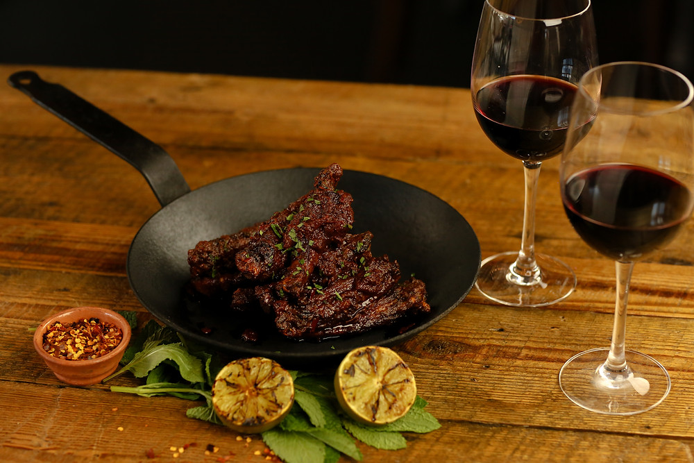 Carnita-Style Duck Wings with Harissa Butter and Grilled Lime, paired with Terrazas de los Andes Reserva Malbec