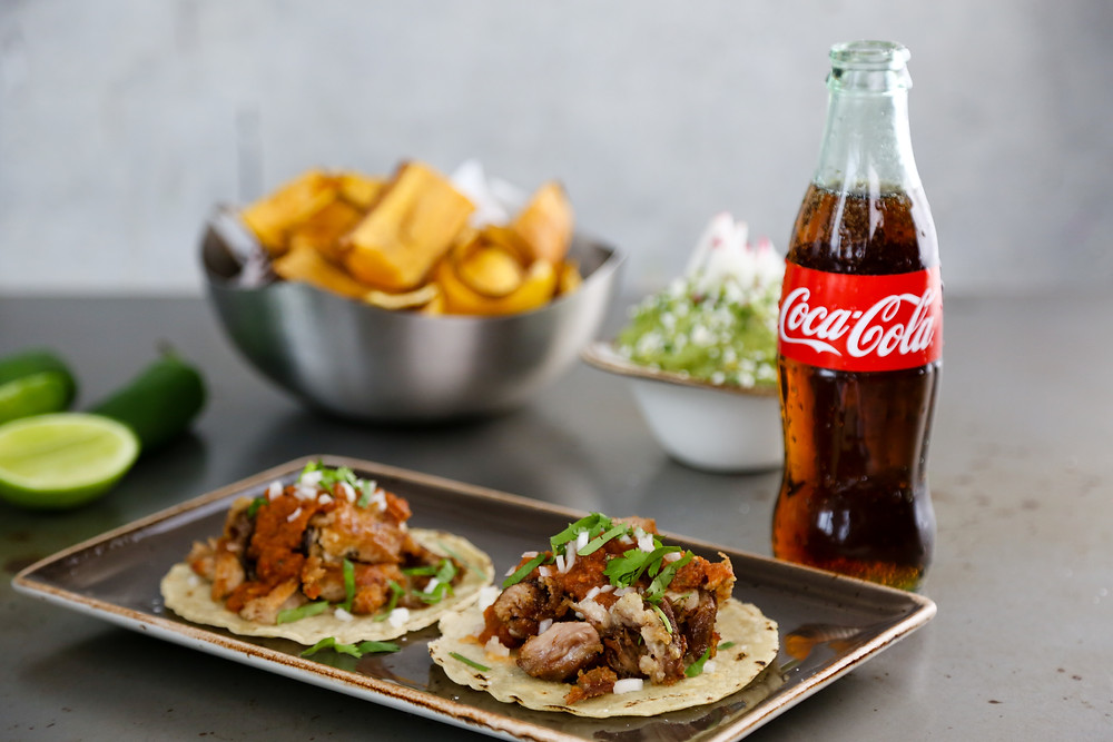 Carnitas Taco and Coca-Cola Bottle