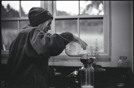 Farmer Straining Milk