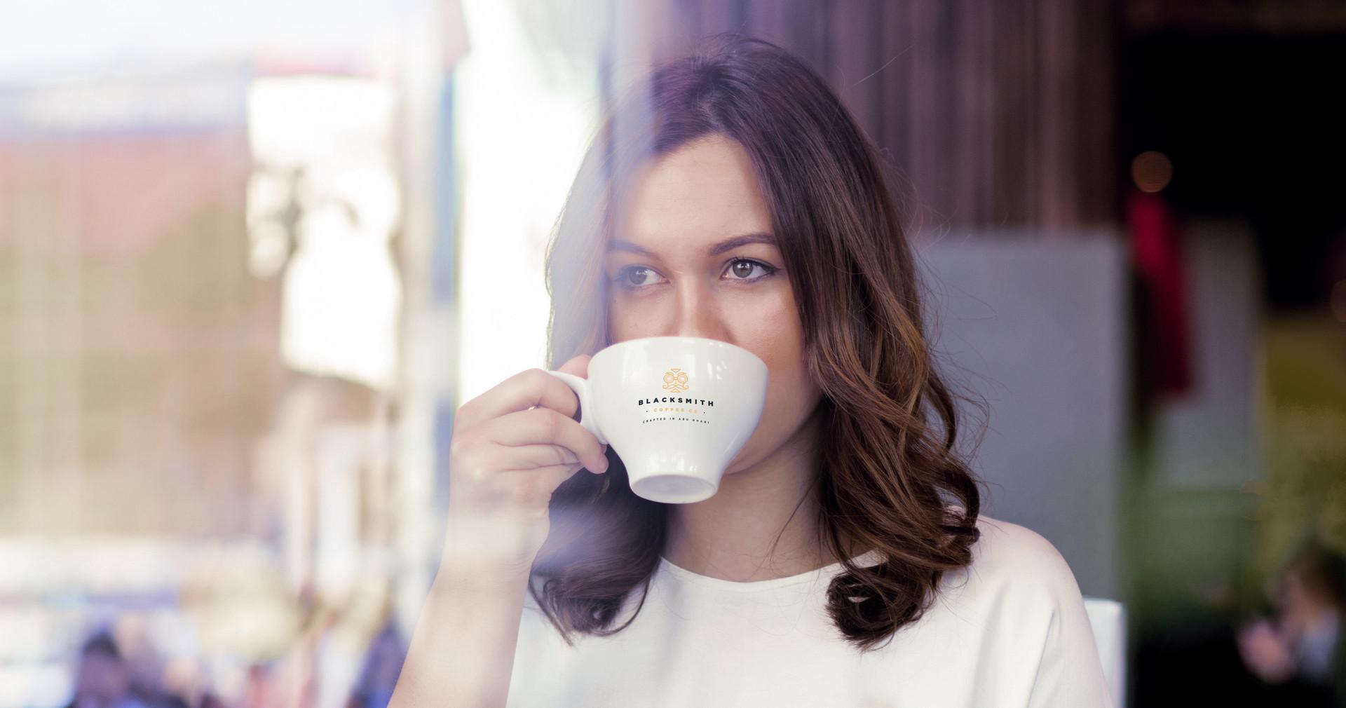 blacksmith-coffee-woman drinking.jpg