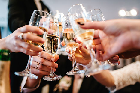 Photo of people clinking their champagne glasses