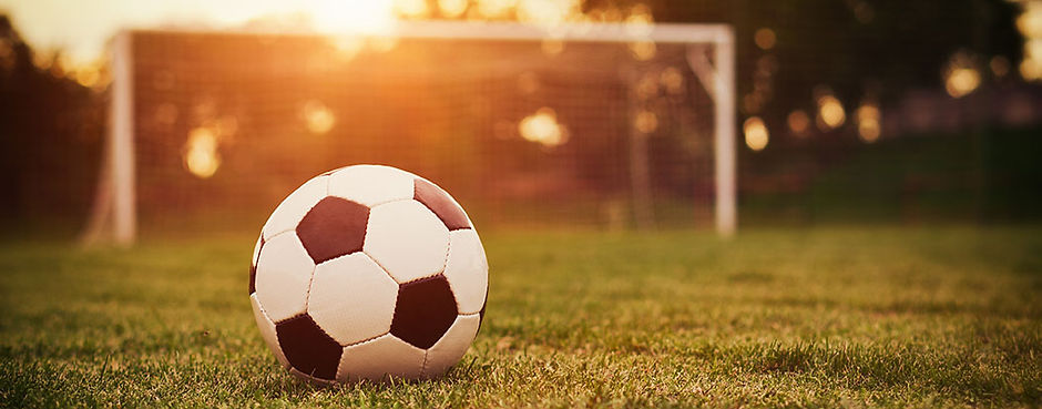 Soccer-ball-on-field-in-sunlight.jpg