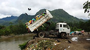Dump truck dumping toxic medical waste