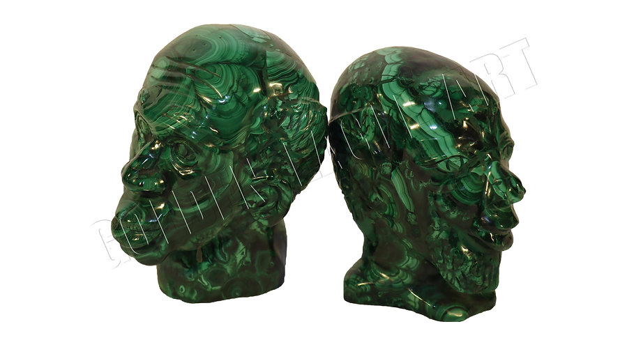 Malachite stone carved African human faces