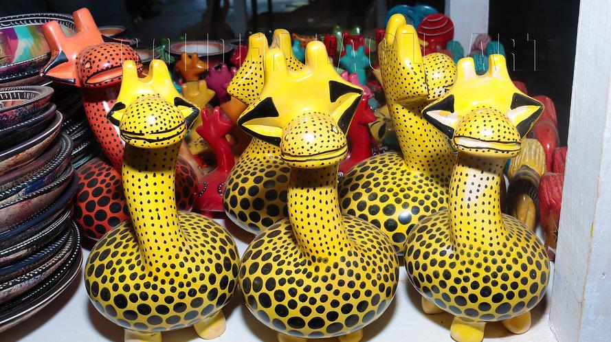 Colored cartoon soapstone giraffes