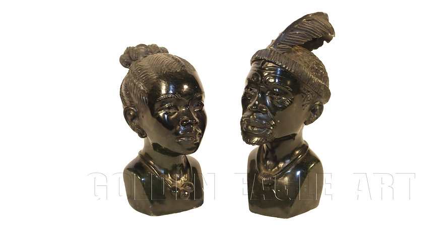 A pair of carved varadite stone African busts