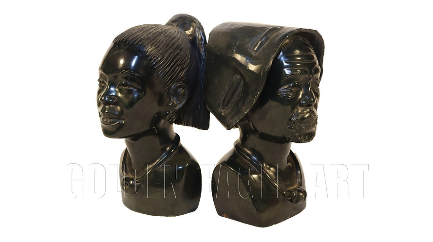 A pair of carved varadite stone Africa couple faces