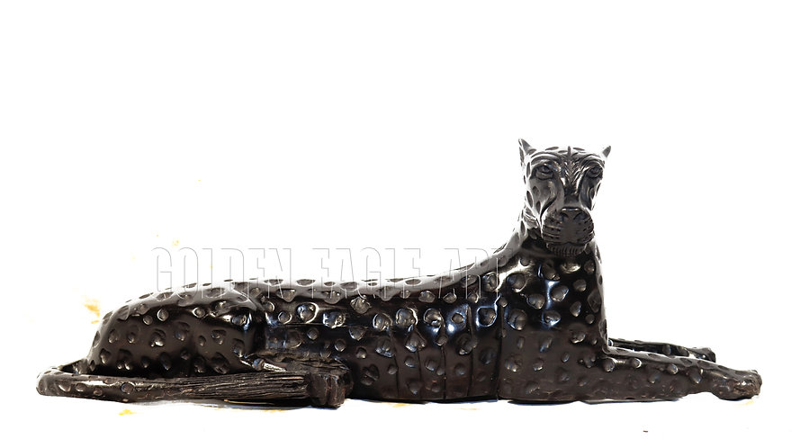 Sitting ebony cheetah