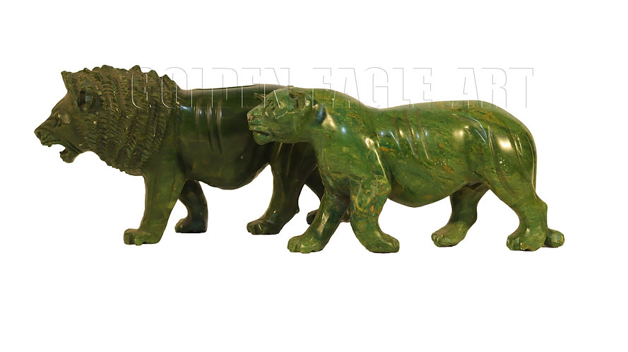 Carved varadite stone lion and lioness couple