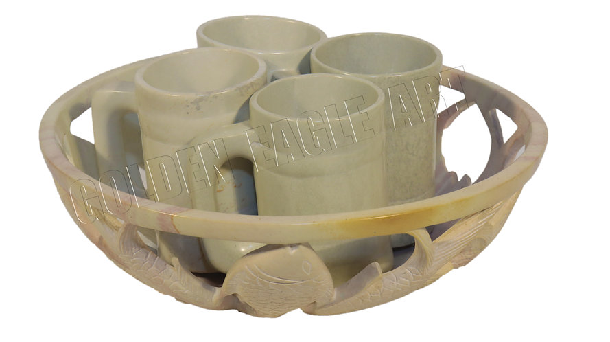 A set of soapstone bowl with 4 cups