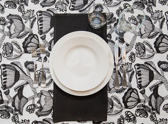 White crockery, black serviette