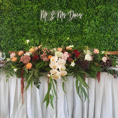 Silk Lining and Green wall behind bridal table in marquee