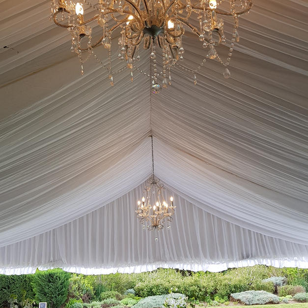 Marquee with silk lining and chandeliers