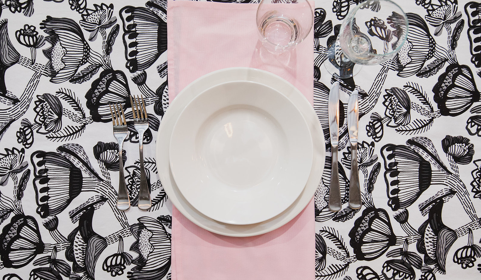 White crockery, pink serviette