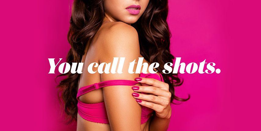 you call the shots, brunette girl with pink bikini and pink nails, pink background showgirls brisbane strip club