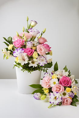 two-bouquets-different-sizes-white-paper