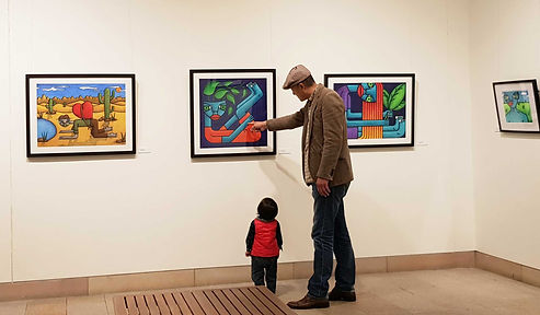 Man-and-Child-at-Exhibition.jpg