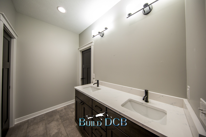 double sink and light fixture bath
