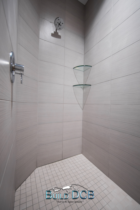 white tile shower glass shelves