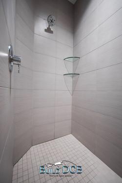 white tile shower glass shelves