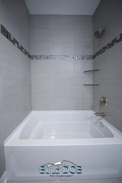 shower tub granite tiling