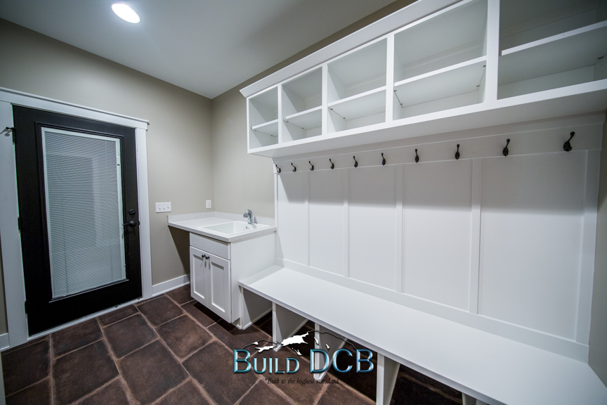 laundry hangers white cabinets