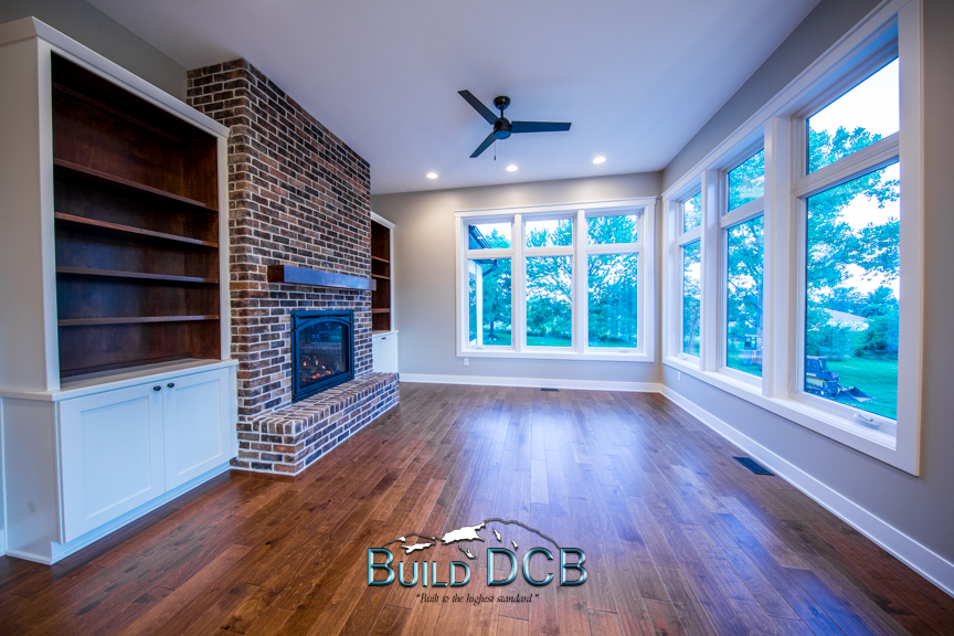 fireplace large windows wood floors