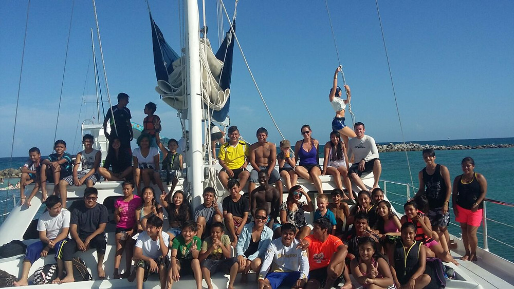 This was our second big activity for our students!. CATAMAYA sponsored Empowering our Youth with an exciting afternoon tour in one of the biggest and beautiful catamaran in Puerto Aventuras. Our students had a great day swimming, dancing while yummy food and drinks were served by the hospitable crews. Indeed it was an unforgettable experience for everyone!!! A big thanks to CATAMAYA  and Amy Hughes who coordinated this activity! Swimming time.