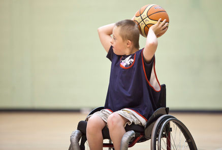 young boy in wheelchair basketball.jpg