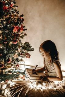 girl in a christmas tree