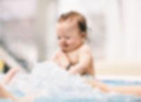 little-baby-girl-splashing-in-the-water-