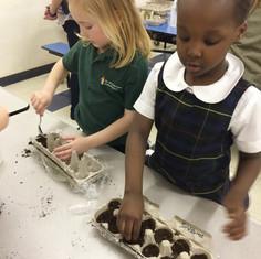 2 girls planting seeds.jpg