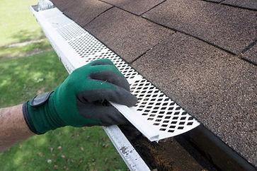 "<img src=""gutterinstallation.png"" alt=""installing K style gutters on house"">"