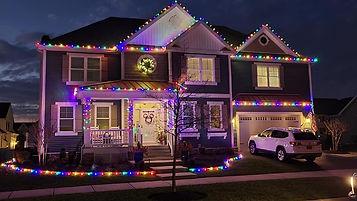 "<img src=""christmaslights.png"" alt=""christmas lights along roof line of house"">"