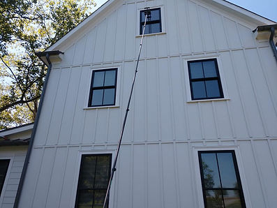 """<img src=""""window cleaning.png"""" alt=""""washing two story window with water pole"""">"""