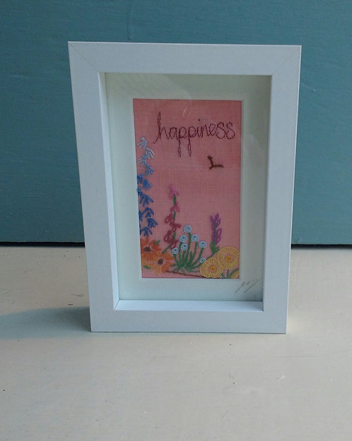 Embroidered 'happiness' frame