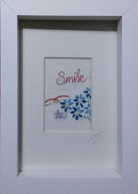 Embroidered 'Smile' frame
