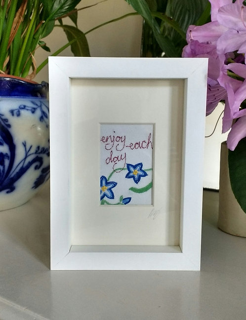 Embroidered 'enjoy each day' frame