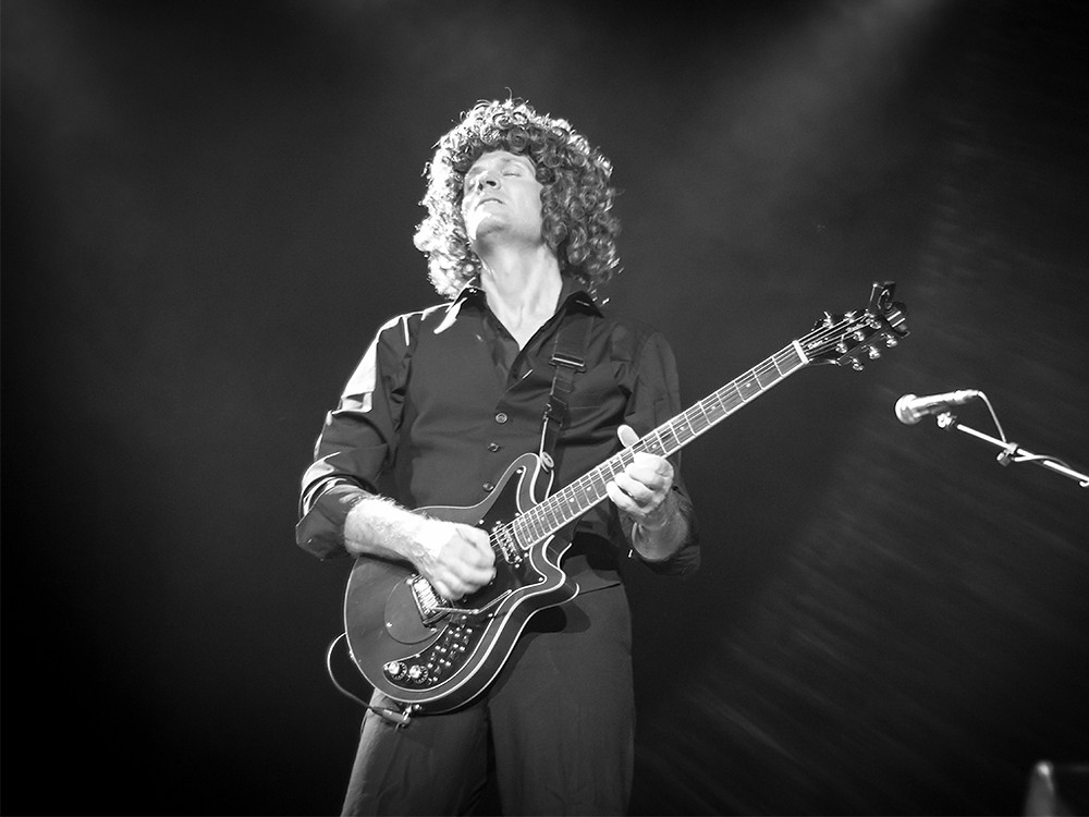 Peter Southern performing as Brian May in Queen Tribute Band Majesty