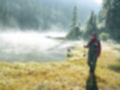 Colorado stream with fisherman