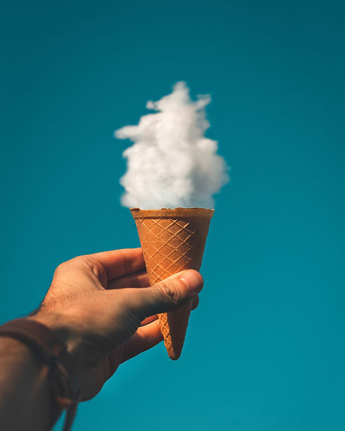 man-holding-ice-cream-cone-under-cloud-1
