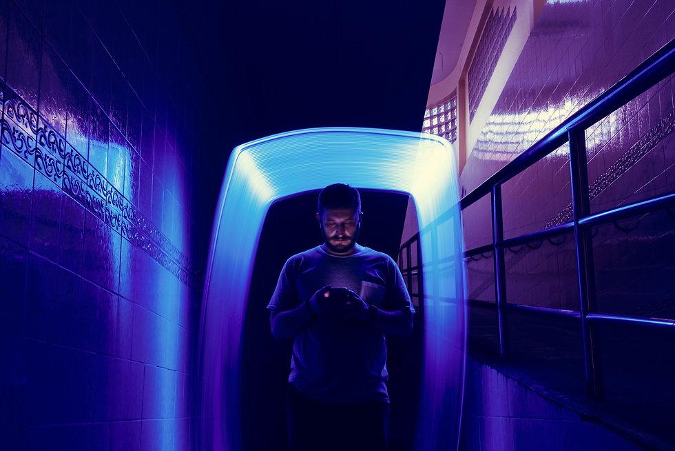 man-standing-with-blue-light-long-exposu