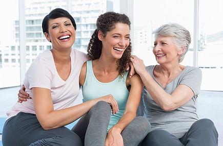 three_women_sitting_together.jpg
