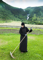 Abbess Thavoria working in the garden. Summer 2015 Photo by Svein Brimi