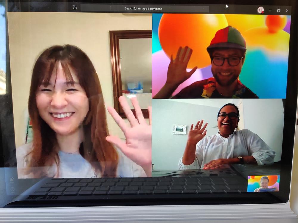 Andrew, Muzi, Nathalie on webcam waving during Christina's viva celebration.